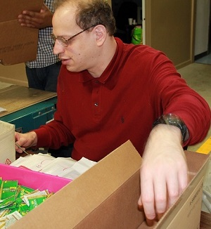 Eric Packages Items at the Work Center
