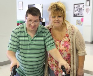 Man w disability and Woman smiling