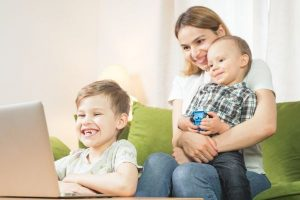 Woman and two children remote fun
